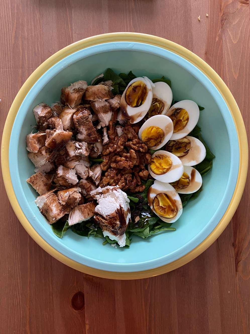 Cobb Salad with grilled chicken, boiled eggs, sweetened and butter fried walnuts, almond milk ricotta and hickory balsamic vinegar.